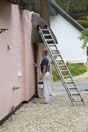 Painter painting a house photo