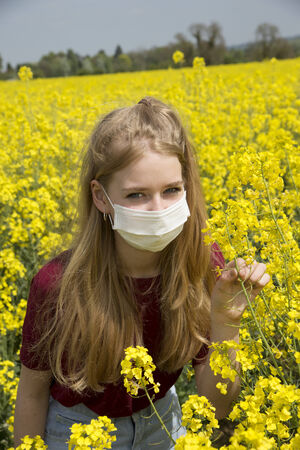 sufferer: Portrait of a teenage girl wearing a face mask allergy sufferer Stock Photo