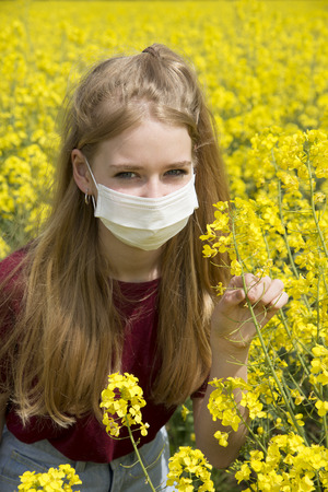 hypersensitivity: Portrait of a teenage girl wearing a face mask allergy sufferer Stock Photo