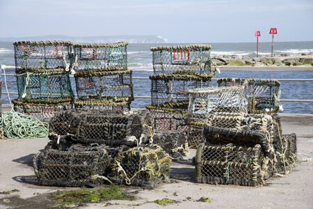 lobster pots: Crab and lobster pots on the quay at Mudeford Dorset England