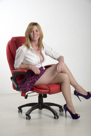 age forty: Woman sitting on a red leather chair
