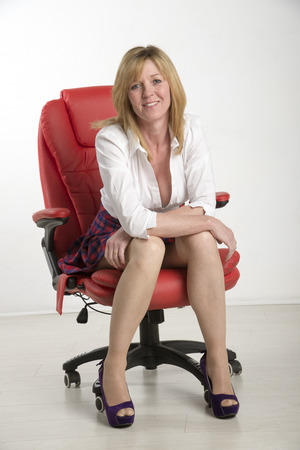 secretarial: Woman sitting on a red leather chair