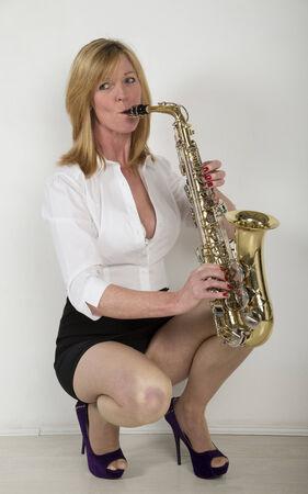 Woman playing a saxophone photo