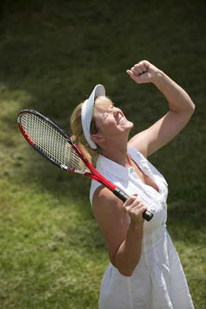 Jubilant female tennis player photo