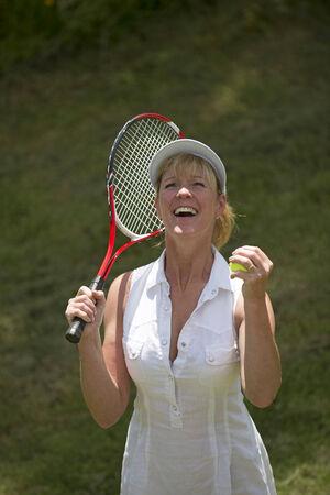jubilating: Jubilant female tennis player