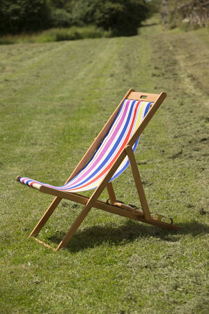 stripped: Colorful stripped deck chair open on the grass