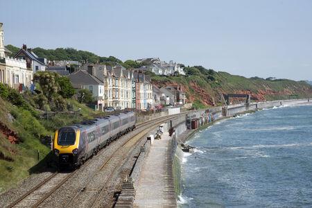 Cross country service passenger train at Dawlish Devon UK Archivio Fotografico