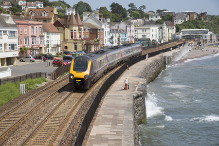 Cross country service passenger train at Dawlish Devon UK Editoriali