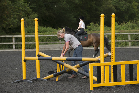 Building a jump for ponies and horses in a riding school