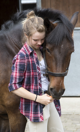 Young rider with her pony Archivio Fotografico