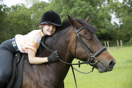 Young rider with her pony Stock Photo