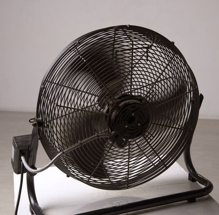 airflow: Fan blades turning to produce cool air Stock Photo