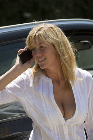 Attractive woman using a mobile phone photo