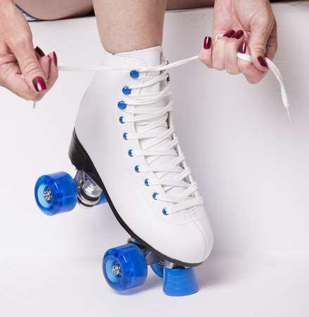 quad: Lacing up a quad skate boot Stock Photo
