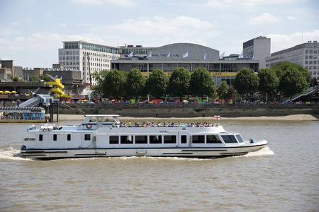 Sapele a tour boat passing The Royal Festival Hall on the River Thames London UK