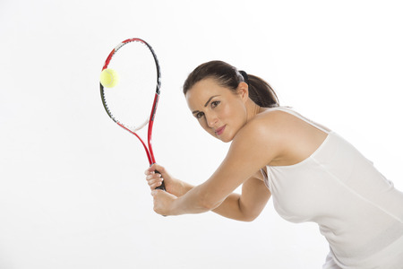 raquet: Attractive female tennis player holding the raquet with two hands