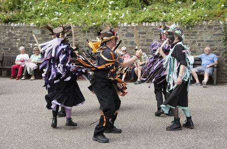 morris: Morris dancers with blackened faces performing on the harbour at Ilfracombe north Devon UK