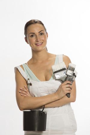 Painter wearing bib   braces overall holding brush photo