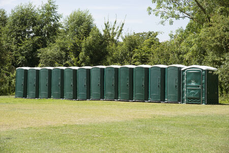 Plastic portable toilets standing in a field