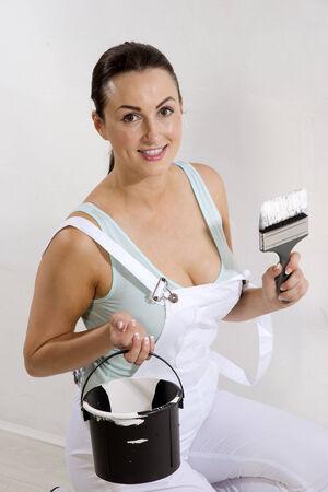 bib overall: Painter wearing bib   braces overall holding brush
