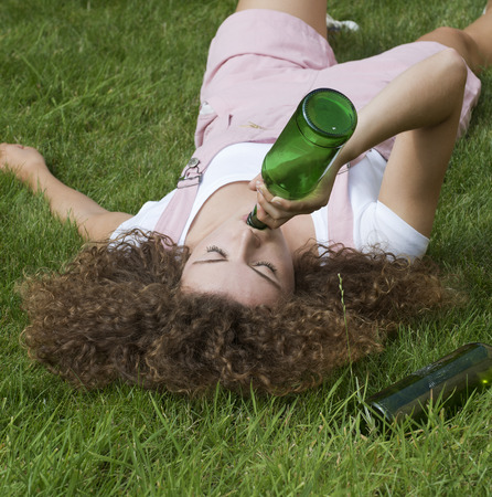 drunk girl: Teenage drinking problem Girl with beer bottle Stock Photo