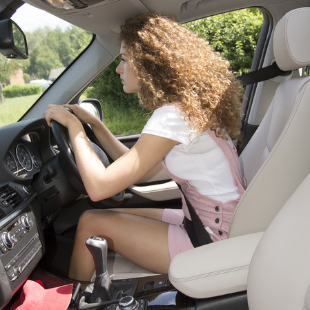 Bad posture and bad driving position  Female motorist Stock Photo