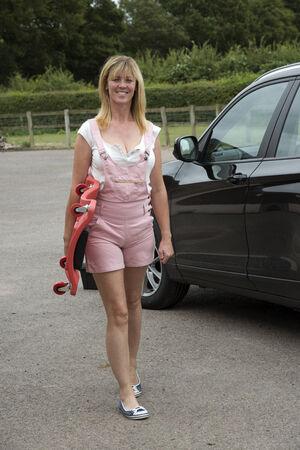 crawler: Female motorist carrying a car crawler