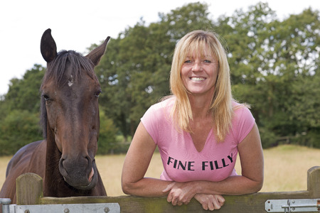 filly: Woman in T shirt Fine Filly and horse