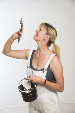 Painting and decorating woman with paint brush photo