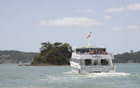 outbound: Passenger tour boat outbound Paihiia Bay of Islands New Zealand Editorial