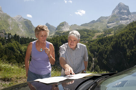 Motorists map reading with a backdrop of mountains South West France photo