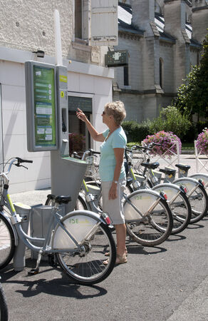 cash cycle: Cycle hire system in Pau city centre southwest France Editorial