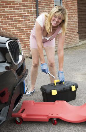 crawler: DIY car maintenance Woman driver with crawler