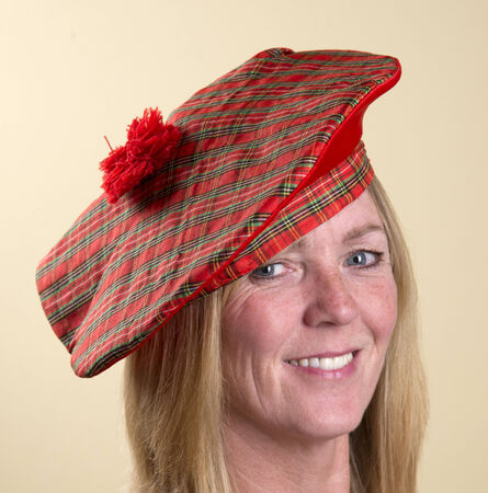 tammy: Portrait of a woman wearing a Tam o Shanter Scottish hat