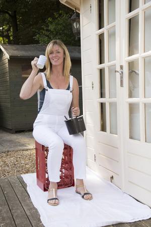 Female painter decorator drinking a mug of tea photo