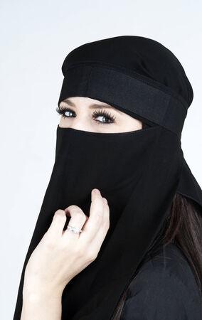 Young woman wearing a Niqab photo