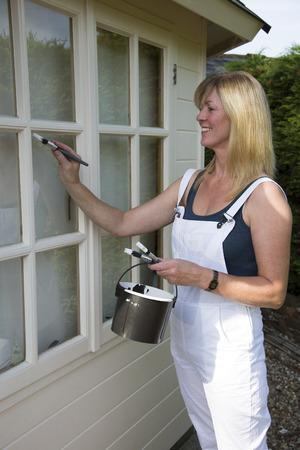 Painter decorator painting windows photo
