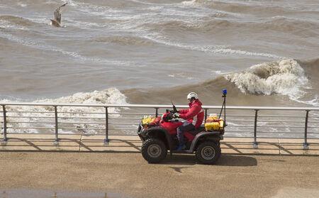 lancashire: Beach patrol officer on quad bike Blackpool UK