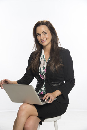 Woman with laptop computer balanced on her knee