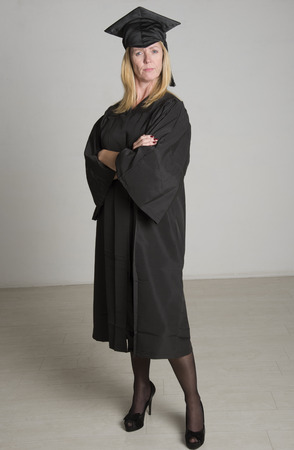 Mature university student in cap and gown photo