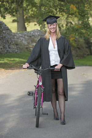Mature university student with bicycle photo