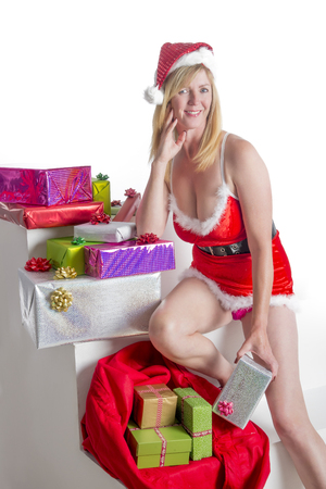 Female Santa with Christmas presents photo
