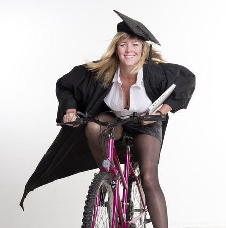 Mature University student and bicycle photo