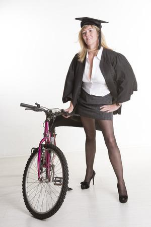 mini bike: Mature student wearing mini skirt with bicycle Stock Photo