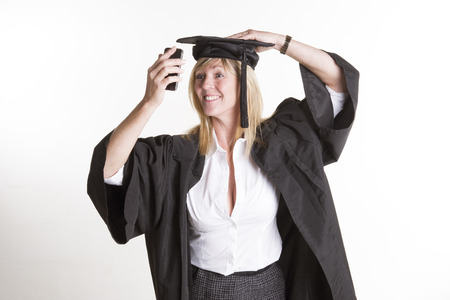 Student in cap and gown taking a selfie photo photo