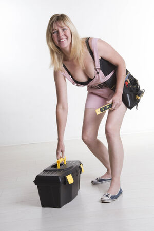 DIY attractive female worker with tools and toolbox photo