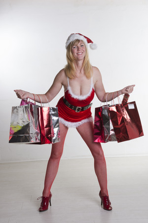 Sexy Santa with Christmas shopping bags