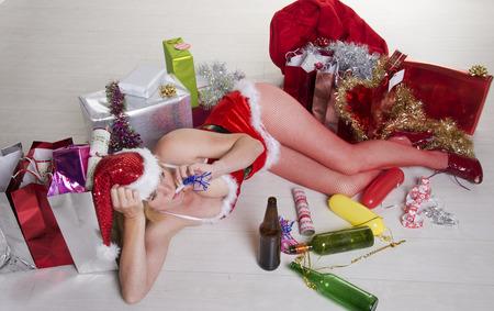 Female party goer in fancy dress drinking alcohol photo