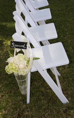 reserved seat: Flower display at end of reserved white seats