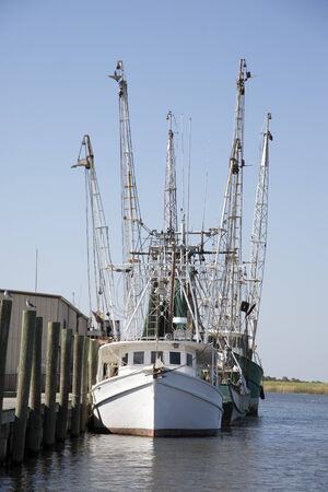 shrimp boat: Shrimp boats and trawl arms